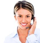 Female telemarketing agent wearing a headset - isolated over white